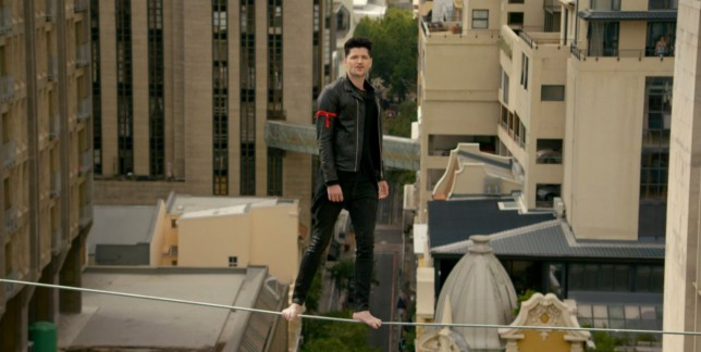 EXCLUSIVE: Watch Danny O'Donoghue's tightrope walking skills in The Script's new Man On A Wire video