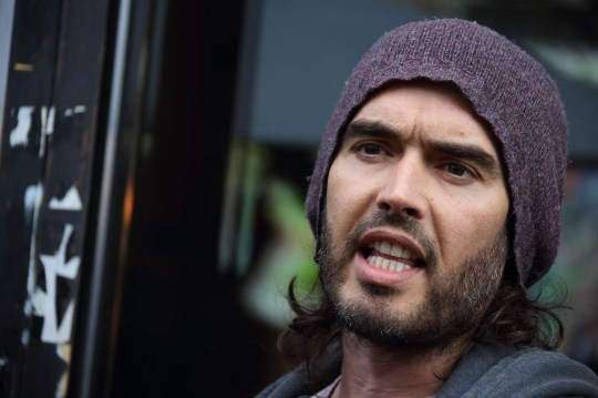 LONDON, ENGLAND - MARCH 26: Russell Brand opens the Trew Era Cafe on March 26, 2015 in London, England. The Trew Era Cafe is a social enterprise community project on the New Era estate. Russell Brand will be donating 100% of his money for his book 'Revolution' to The Trew Era Cafe. Mike Marsland/WireImage