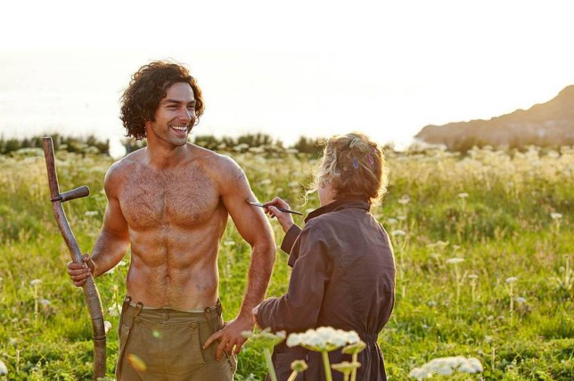 For use in UK, Ireland or Benelux countries only  Undated BBC handout photo of Poldark star Aidan Turner getting the brush-off from a crew member in this behind-the-scenes shot from the BBC's latest costume drama. PRESS ASSOCIATION Photo. Issue date: Friday March 6, 2015. Turner plays the title character in the remake of the classic series based on Winston Graham's Cornish saga. The original version attracted audiences of 15 million when it was first broadcast by the BBC in the 1970s. See PA story SHOWBIZ Poldark. Photo credit should read: BBC/PA Wire NOTE TO EDITORS: Not for use more than 21 days after issue. You may use this picture without charge only for the purpose of publicising or reporting on current BBC programming, personnel or other BBC output or activity within 21 days of issue. Any use after that time MUST be cleared through BBC Picture Publicity. Please credit the image to the BBC and any named photographer or independent programme maker, as described in the caption.