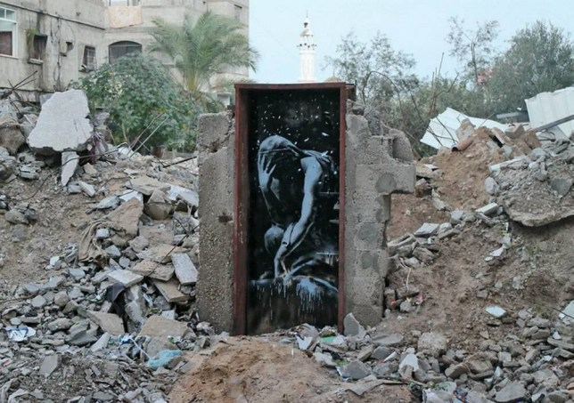 A Palestinian man said he was tricked into selling this £400,000 Banksy mural - for just £118. See SWNS story SWBANKSY; The street artist visited Gaza in February and created a number of politically-motivated murals using the rubble and destroyed homes. He painted a striking weeping Greek goddess on the only remaining door of Rabie Darduna's ruined house - one of thousands of homes demolished last year.  But Mr Darduna said he was duped into selling the piece to a man who pretended he worked for the elusive artist and paid him just 700 shekels - or £118.