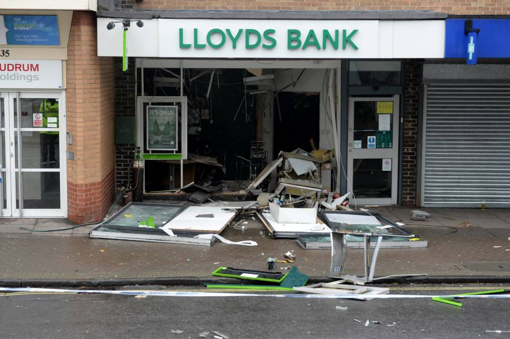 "Police are investigating a raid on an ATM cash machine at Lloyds Bank in Shirehampton.  These incredible pictures reveal how the entire front wall of a bank was blown off by thieves who stole the cash machine.  See SWNS story SWATM.  The raid saw the front facade of Lloyds bank in Shirehampton, Bristol, blasted across the pavement and road at around 2am on Friday morning.  An eyewitness described seeing a gang of seven or eight men wearing black balaclavas swarm into the building before making off with cash.  The man, who was working nearby and asked to remain anonymous, said: ""I heard this loud bang which was louder than a firework. There was a lot of vibration and smoke.î"