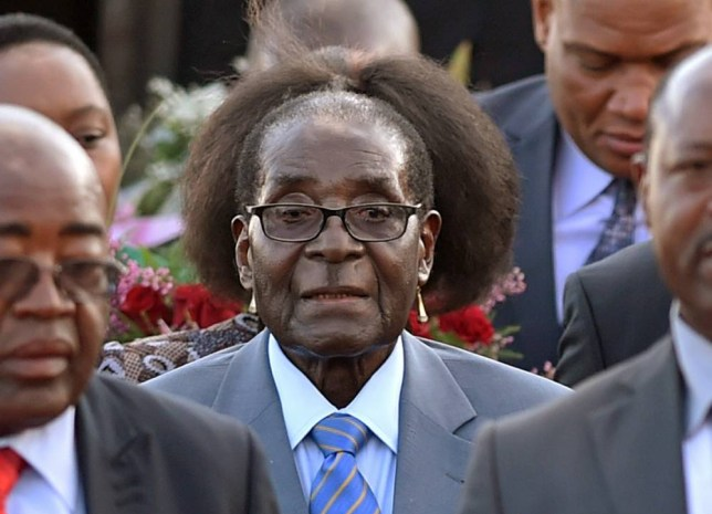 Zimbabwean president, Robert Mugabe, center, arrives in Pretoria, South Africa Tuesday, April 7, 2015 for a state visit to the country.. Mugabe will be in the country until Thursday and will meet with South African president Jacob Zuma Wednesday.(AP Photo)