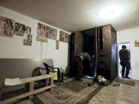 Mexican soldiers uncover secret route to US hidden behind a wardrobe