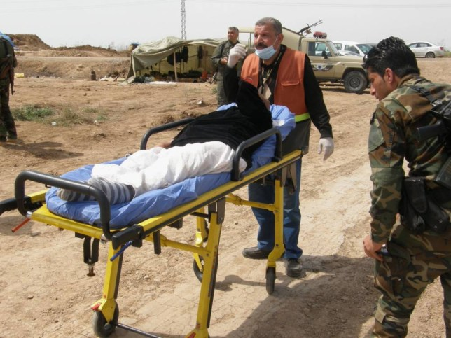 A Yazidi released by Islamic State group militants is carried on a stretcher as he and other people of the religious minority arrive in Kirkuk, 180 miles (290 kilometers) north of Baghdad, Iraq, Wednesday, April 8, 2015. The Islamic State group released more than 200 Yazidis on Wednesday after holding them for eight months, an Iraqi Kurdish security official said, the latest mass release of captives by the extremists. (AP Photo)