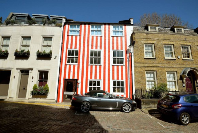 A red and white striped house in South End, Kensington, London, which was apparently painted by the owner in protest at a planning application being turned down on improvements to the property. PRESS ASSOCIATION Photo. Picture date: Tuesday April 14, 2015. See PA story SOCIAL House. Photo credit should read: John Stillwell/PA Wire