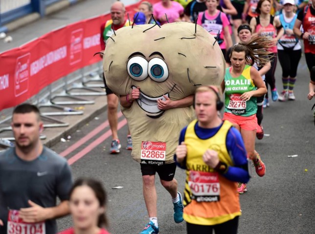 A Marathon runner in fancy dress during the 2015 Virgin Money London Marathon. PRESS ASSOCIATION Photo. Picture date: Sunday April 26, 2015. See PA story ATHLETICS London. Photo credit should read: Adam Davy/PA Wire