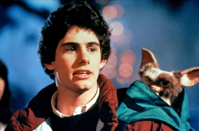 Film: Gremlins (1984), starring Zach Galligan as Billy Peltzer and Gizmo. Directed By JOE DANTE  08 June 1984  AFB5217  Allstar/WARNER BROS  **WARNING** This Photograph is for editorial use only and is the copyright of WARNER BROS  and/or the Photographer assigned by the Film or Production Company & can only be reproduced by publications in conjunction with the promotion of the above Film. A Mandatory Credit To WARNER BROS is required. The Photographer should also be credited when known. No commercial use can be granted without written authority from the Film Company.