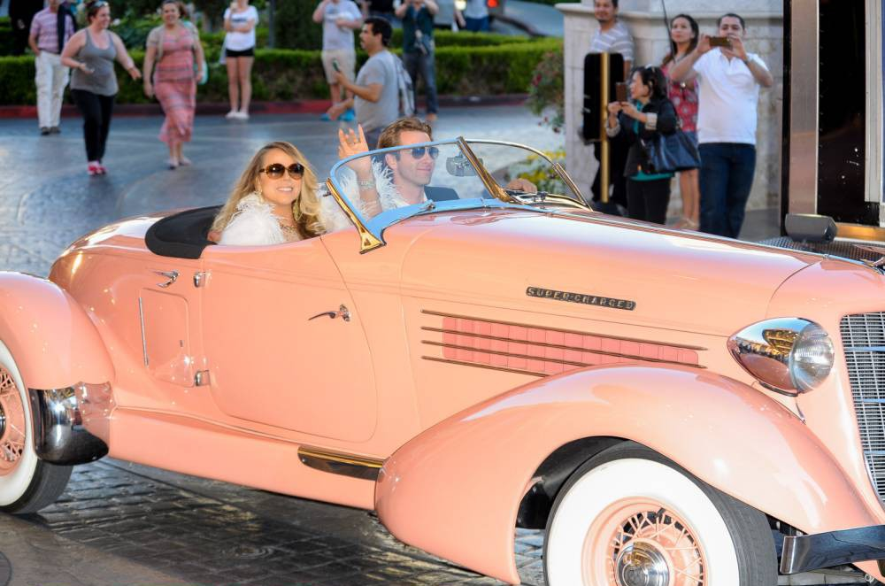 Mariah Carey emulates Lady Penelope as she rides into Caesars Palace to mark the start of her Las Vegas residency