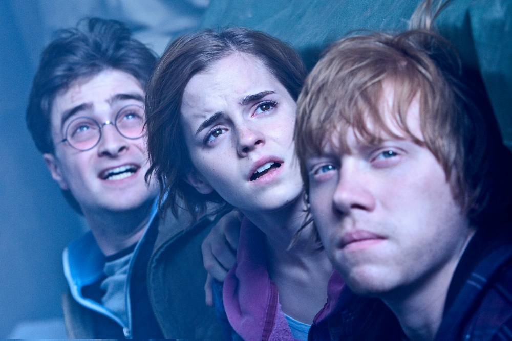 FILMS: HARRY POTTER AND THE DEATHLY HALLOWS PART 2 (L-r) DANIEL RADCLIFFE as Harry Potter, EMMA WATSON as Hermione Granger and RUPERT GRINT as Ron Weasley. Warner Bros. Pictures fantasy adventure , a Warner Bros. Pictures release.
