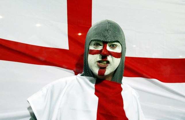 An English supporter, wearing a chainmail and waving the flag of St George, arrives for the quarter-final Rugby World Cup 2003 match between England and Wales at the Suncorp Stadium in Brisbane, 09 November 2003. AFP PHOTO/Christophe SIMON (Photo credit should read Christophe SIMON/AFP/Getty Images)