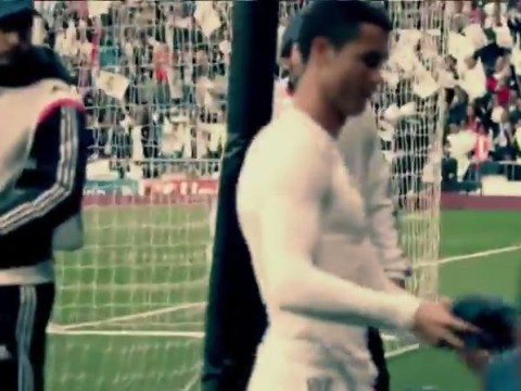 Cristiano Ronaldo gives young Real Madrid fan his shirt after accidentally hitting him with free-kick