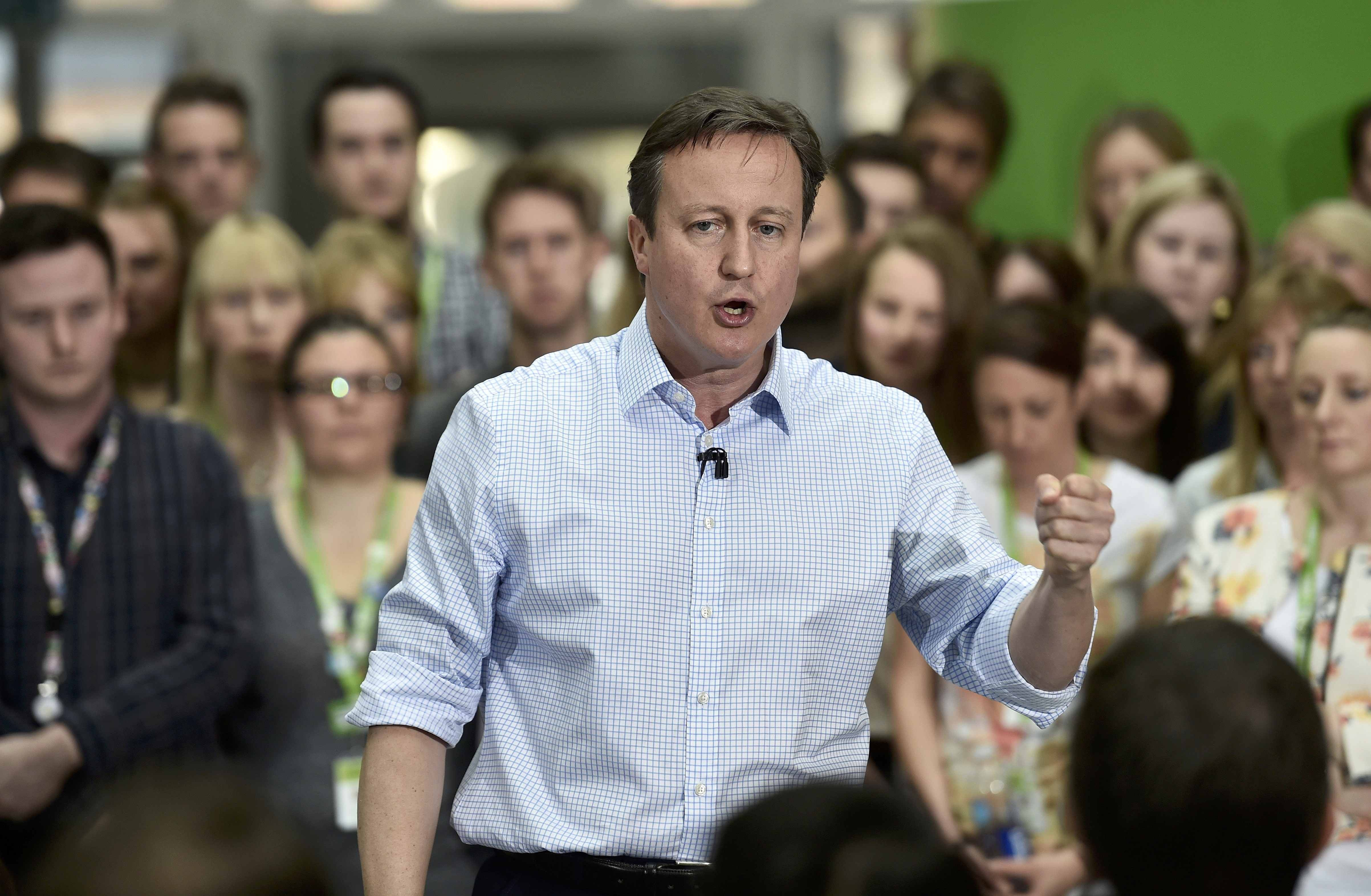 Cameron accidentally calls the election 'career defining', quickly correcting himself to say 'country defining'