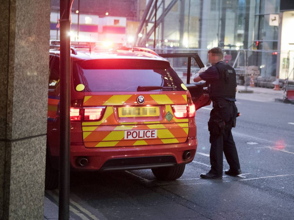 Police use emergency lights and park on yellow lines… to