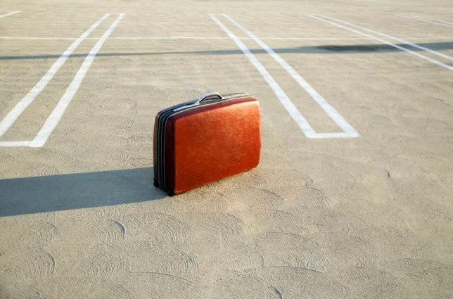 A suitcase in a car park