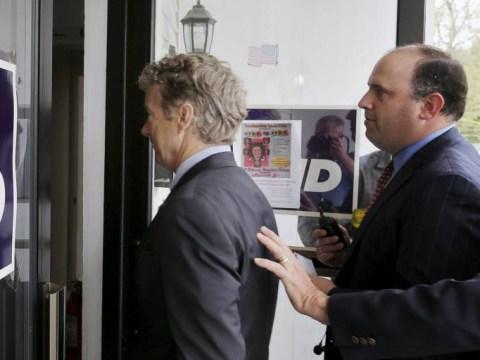 American political aide licks camera lens at Republican meeting