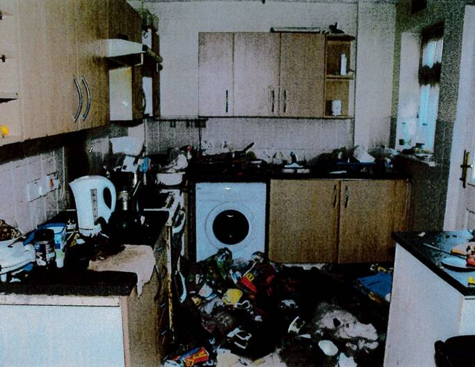 The inside of a house in Knowsley, Merseyside, where a decomposed body was found in an upstairs bedroom. A mother admitted neglect by allowing her children to visit the property where her brother's body was still in a bedroom. None of the people involved, nor the address, can be identified.