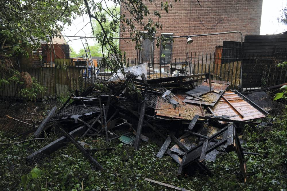 GV of the house on Kenyon Way in Little Hulton, Salford, Greater Manchester where four dogs have died after a blaze tore through a network of kennels and sheds in the garden. Eight other dogs were rescued by firefighters and by a man who stood in the garden fighting the flames with a hosepipe before the fire crews arrived. Firefighters resuscitated two further dogs including an eight-month-old terrier using oxygen and heart massage therapy.
