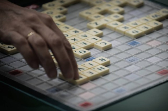 LONDON, ENGLAND - NOVEMBER 19:   A competitor in action during rounds 1 to 3 of the 24-round Scrabble Champions Tournament, during the Mind Sports International World Championships held  at ExCel on November 19, 2014 in London, England.  (Photo by Gareth Cattermole/Getty Images)