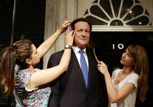 Caryn Mitman (left) and Clare Galvin put the finishing touches on a refresh of Prime Minister David Cameron's wax figure at Madame Tussaud's in London, five years after its original inclusion and ahead of the Queen's speech. PRESS ASSOCIATION Photo. Picture date: Tuesday May 26, 2015. Photo credit should read: Yui Mok/PA Wire