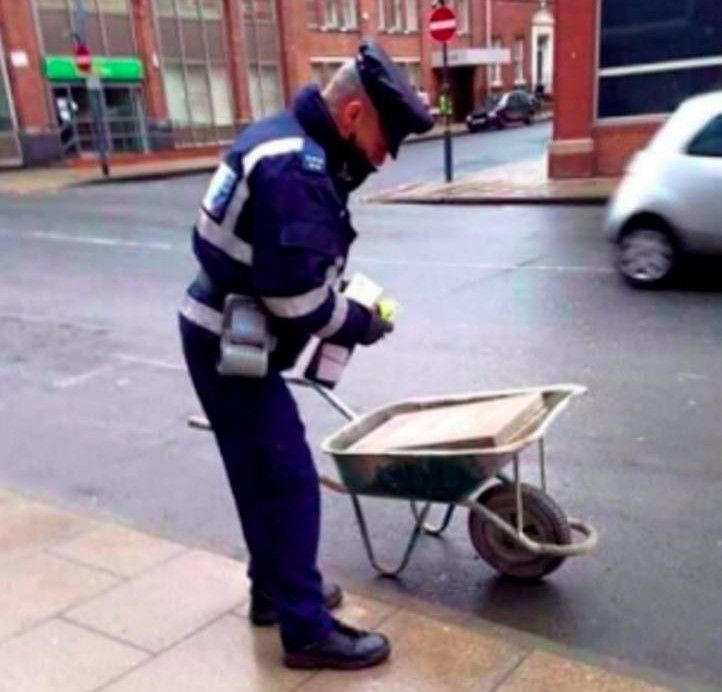 These images show the unbelievable moment a Leeds traffic warden puts a parking ticket on a WHEELBARROW. See Ross Parry copy RPYTICKET : The jobsworth parking attendant is spotted writing out then placing a ticket on the offending garden item.  It is not quite clear what traffic offence the owner of the wheelbarrow committed when they placed it on the street in Leeds, West Yorks.