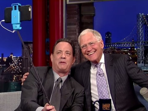 David Letterman has a dad moment as Tom Hanks teaches him how to use a selfie stick