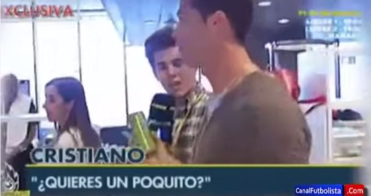 Cristiano Ronaldo offers his drink to a journalist