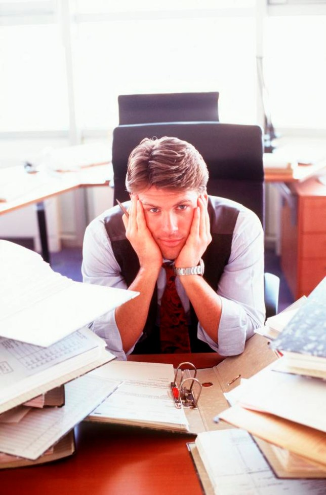 Overworked Businessman at Desk BUSINESS BUSINESSMEN MEN OFFICE WORKERS OFFICES POSED BY MODELS STRESS WORK EXPERIENCE WORKING