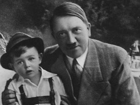 Nazi poster child who posed with Hitler reveals the truth behind shots