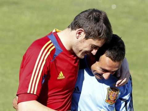 Santi Cazorla wants Real Madrid's Iker Casillas to make Arsenal transfer but admits move is unlikely to happen