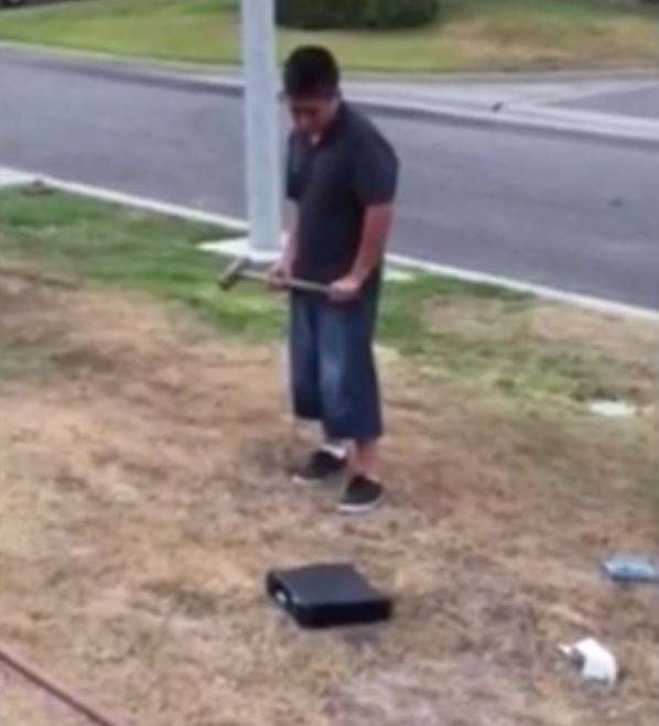 Dad makes boy pummel his first love (an Xbox) with sledgehammer after he gets bad grades