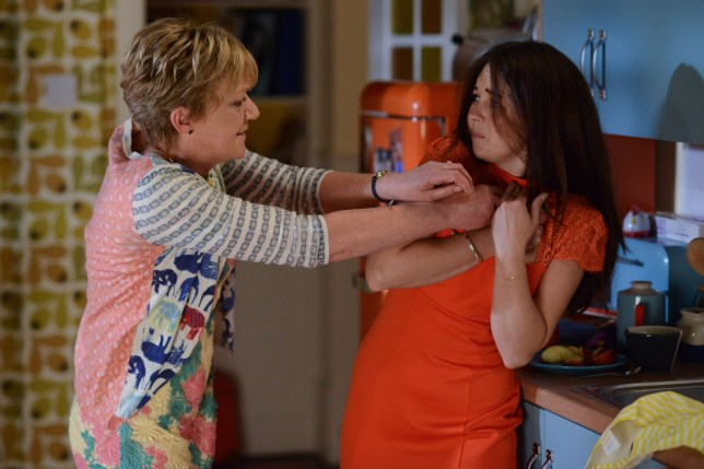 WARNING: Embargoed for publication until 30/06/2015 - Programme Name: EastEnders - TX: 06/07/2015 - Episode: 5097 (No. n/a) - Picture Shows: Jean is shocked when she sees a key around Stacey's neck and tries to grab it.   Jean Slater (GILLIAN WRIGHT), Stacey Branning (LACEY TURNER) - (C) BBC - Photographer: Kieron McCarron