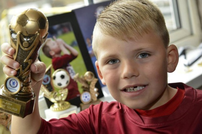 """A seven-year-old named after Steven Gerrard is hoping to follow in the Liverpool star's footsteps - after scoring a staggering 97 goals in just one season.  Blaze Gerrard-Carl Brown has scored from the halfway line and in two matches against the same side found the net an incredible 16 times - despite playing one half in goal. The 4ft-tall youngster hopes to follow in the steps of the England star he was named after and become """"the new Steven Gerrard.""""  Pint-sized Blaze, who is from Brighton, East Sussex, and plays for Woodingdean Youth Blue under-sevens in the county, has also scored 16 other goals in two separate tournaments this season.  SEE OUR COPY FOR DETAILS. Pictured:  Blaze Gerrard-Carl Brown. © Brighton Argus/Solent News & Photo Agency UK +44 (0) 2380 458800"""