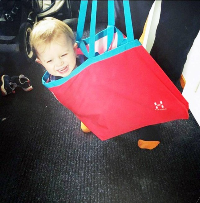 """Pic shows: Axel, 2 year old. A dad who decide to grow a beard and then put his son in a bag rather than carry on his shoulders sparked a police alert when neighbours thought he was a burglar. The incident happened at a house in the Sundbyberg suburb of the capital Stockholm where Torkel Kristoffers, 39, had decided to grow a beard while taking a break from work to look after his son. The two-year-old had asked his dad to pick him up rather than having to walk the last 30 m to the house where he was visiting a friend. To make it more fun, the dad agreed to the latch request that he ride in the shopping bag. But a woman neighbour who knew Torkel but did not recognise him with the beard called police to say he had seen a robber with a bag full of loot. The father who was still at the house said it was a bit of a shock when the police burst in but in the end had made light of it, and he had even taken a snap recreating the way he had been carrying the boy which he then posted on Instagram. He dad who runs a cleaning firm said that at first he thought they were staging a rate looking for a legally employed staff. He added: """"My son was playing with his police car on the floor when they came in. They said they were looking for an unknown man that had been reported to them."""" When he got the description of the man however, he realised they were talking about himself. The officers apparently apologised speedily left, and the dad and the friend he was visiting said they weren't annoyed with the female neighbour and even admitted that with the new beard he looked rather wild. Police spokesperson Eva Nilsson confirmed that it had been a misunderstanding and that when the police turned up boy playing on the floor showing that there was no problem. She added: """"It is currently not a crime to carry a child around in a bag."""" (ends)"""