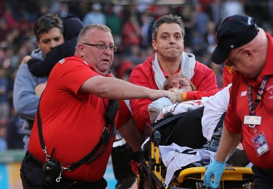 BOSTON, MA - JUNE 5: A fan is attended to by medical staff after she was hit by a broken bat during a game between the Boston Red Sox and the Oakland Athletics in the second inning at Fenway Park on June 5, 2015 in Boston, Massachusetts.  (Photo by J Rogash/Getty Images)