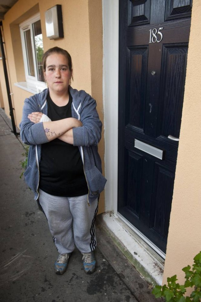 PIC BY DAN ROWLANDS / MERCURY PRESS (PICTURED: FIONA CRABB, 28, WITH THE DOOR SHE WAS SUPERGLUED TO) A woman was SUPERGLUED to her own front door in a cruel prank by bullies ¿Äì only being saved hours later when she was SAWN free. Fiona Crabb was stuck to the door handle for more than three hours as emergency services thought her call was a joke at first. The 28-year-old needed the assistance of paramedics, firefighters and A&E staff to set her free. Emergency services used lubricants, oils and even COLA in a bid to un-stick her ¿Äì but in the end had to take the handle off the door and saw her free in hospital. Fiona has hit out at the unidentified pranksters ¿Äì who she believes she saw running from the block of flats as she arrived home on Thursday evening. SEE MERCURY COPY