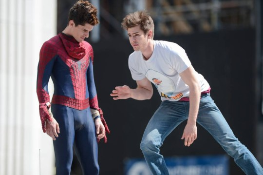 """NEW YORK, NY - JUNE 22:  Actor Andrew Garfield (R) rehearses a scene at the """"The Amazing Spiderman 2"""" movie set in Madison Square Park on June 22, 2013 in New York City.  (Photo by Ray Tamarra/Getty Images)"""
