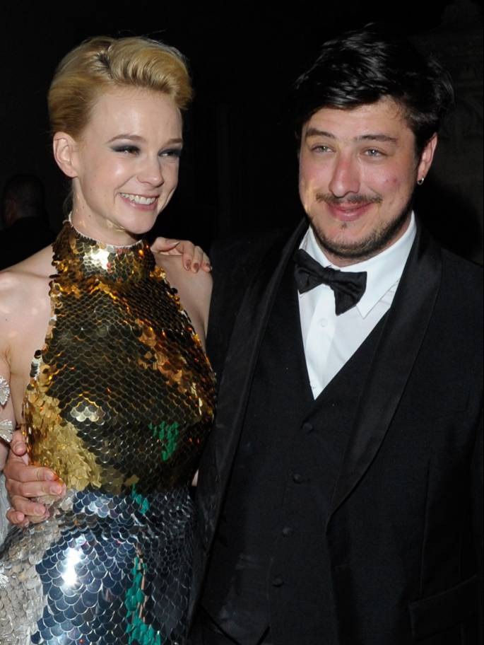 "FILE - JUNE 08: Actress Carey Mulligan and musician Marcus Mumford are expecting their first child together. NEW YORK, NY - MAY 07:   (EDITORS NOTE: This image is a re-crop of original file 144037304) Carey Mulligan (L) and new husband Marcus Mumford attend the after party for the ""Schiaparelli and Prada: Impossible Conversations"" Costume Institute exhibition on May 7, 2012 in New York City.  (Photo by Dave Kotinsky/Getty Images)"