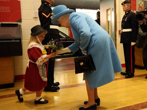 Little girl meets the Queen, presents her with flowers, gets smacked in the head by a soldier