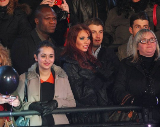 Amy Childs (C) and Brian Belo (back L) attend Celebrity Big Brother 2012 at Elstree Studios on January 27, 2012 in Borehamwood, England. (Photo by Mike Marsland/Wireimage)
