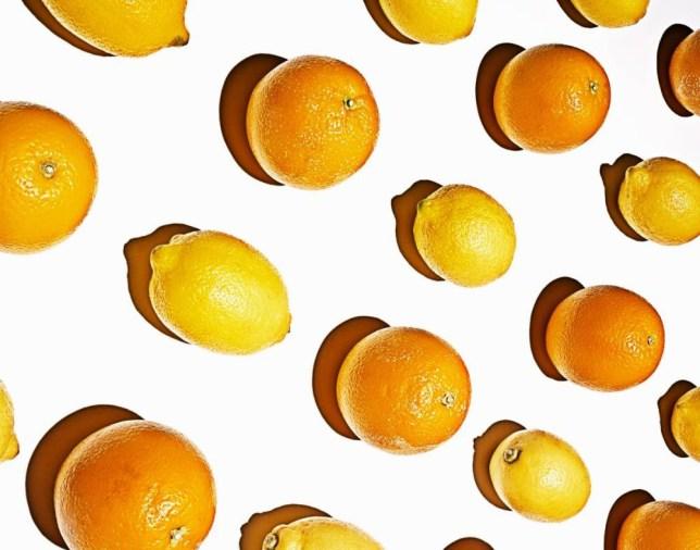 Lemons and oranges arranged in grid