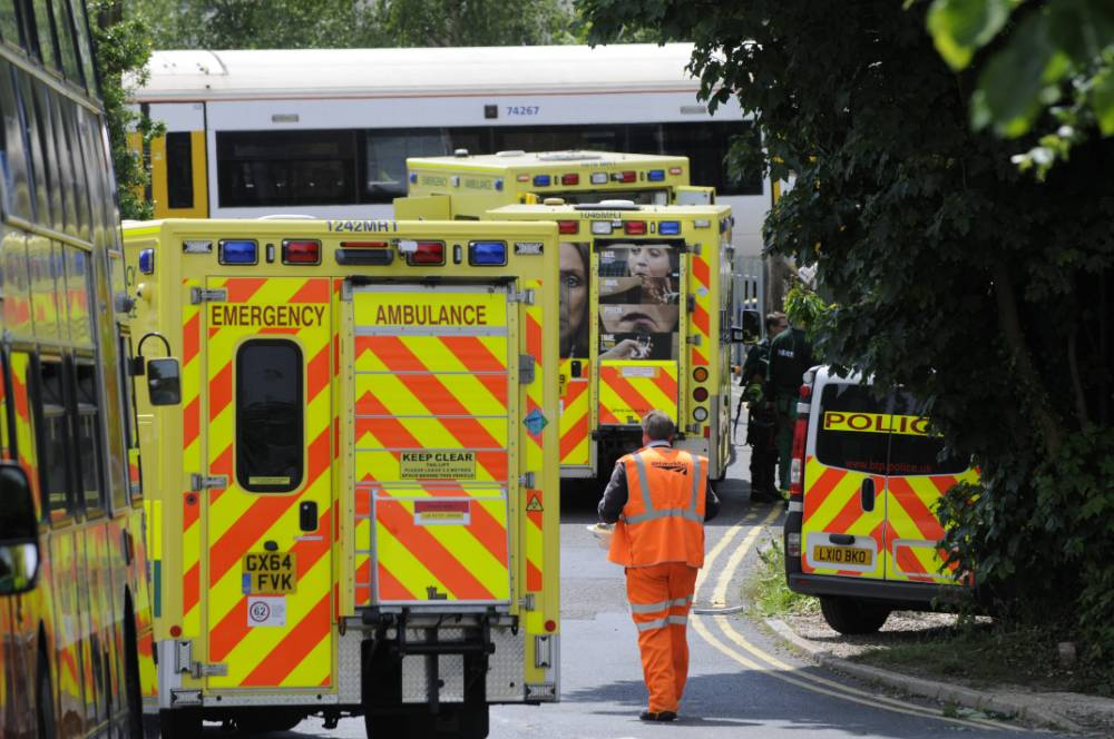 "Emergency crews at Chartham train station, Kent where a man has been killed this morning after being hit by a train.  See MASONS story MNTRACKS; A man has died and a woman is being treated in hospital after they were hit by a train at a station yesterday (Tues) morning. One online comment claimed that the man was 'an absolute hero' who had tried to rescue the woman. The two casualties were seen on the London-bound platform at Chartham, Kent moments before they were struck on the tracks at 10.55am. British Transport Police said they were treating the incident as ""unexplained"" as scores of emergency workers raced to the scene."