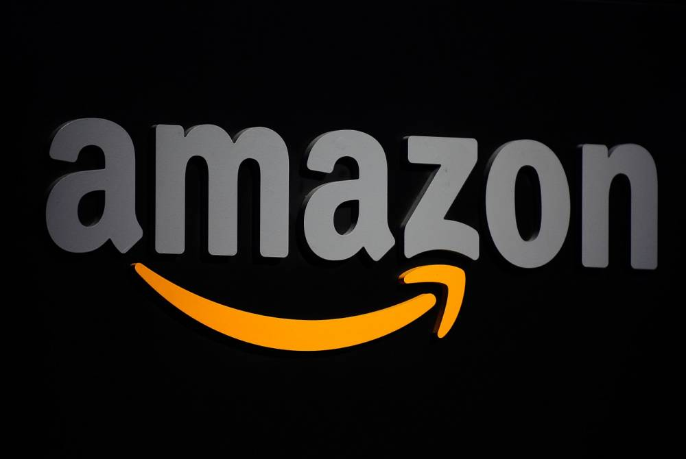 (FILES) This September 28, 2011 file photo shows the Amazon logo during a press conference in New York.  Amazon insisted June 17, 2015 on a significant change to proposed US drone regulations before it introduces 30-minute Prime Air parcel delivery by unmanned aerial vehicles to its American customers. The online retail giant -- a major player in the development of UAVs for civilian missions -- acknowledged safety concerns as the Federal Aviation Administration hammers out a final set of commercial drone-flying rules. But it balked at the FAA's proposal, set out in a notice of proposed rulemaking in February, that small UAVs fly only in full view of their operators on the ground -- not at a distance beyond the line of sight.   AFP PHOTO/EMMANUEL DUNAND / FILESEMMANUEL DUNAND/AFP/Getty Images