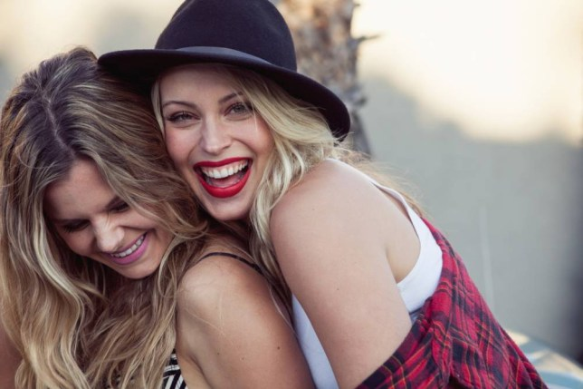 Two female friends smiling, portrait