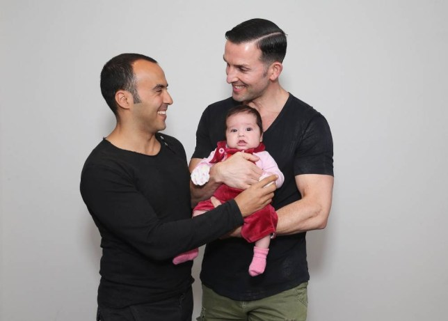 """SYDNEY, AUSTRALIA - MAY 30:  (L-R) Sydney couple, Faycal Dow, aged 38, daughter Myla Dow, aged 2 months, and Hunter Dow, aged 44, pose during a portrait session on May 30, 2015 in Sydney, Australia. Faycal and Hunter were legally married in France last year and had their first child Myla this year and are supporters of same-sex marriage. """" For the sake of our daughter more than anything, it is important that our marriage is recognised as valid in Australia, the country we live in and hope to bring our beautiful daughter up in"""", said Hunter. The marriage equality debate in Australia has reignited on the back of Ireland's referendum legalising same-sex marriage last week. Recent polls suggest public support for gay marriage in Australia is at an all-time high of 72%.  (Photo by Don Arnold/Getty Images)"""