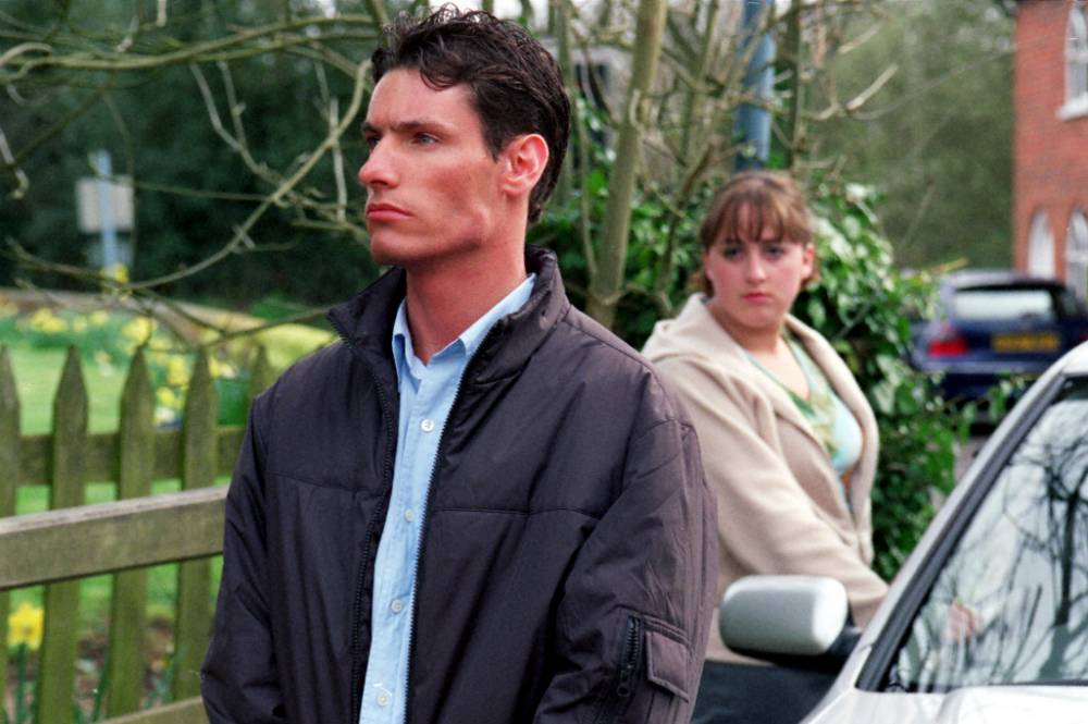 Television programme : EASTENDERS Caption: Picture Shows: DEAN GAFFNEY as Robbie and NATALIE  CASSIDY as Sonia TX: BBC ONE Thursday May 17, 2001 An anxious  Robbie (Dean Gaffney) stands tentatively outside Garry Bolton's ( Bruce Byron) house, bracing himself for his first encounter with  his father. WARNING: This copyright image may be used only to  publicise current BBC programmes or other BBC output. Any other  use whatsoever without specific prior approval from the BBC may  result in legal action.  Credit: © BBC CaptionWriter: Kate Lawson Special: WARNING: This copyright image may be used only to  publicise current BBC programmes or other BBC output. Any other  use whatsoever without specific prior approval from the BBC may  result in legal action. SupCat1: BBC ONE SupCat2: Unmanipulated picture SupCat3: Thursday May 17, 2001 Source:
