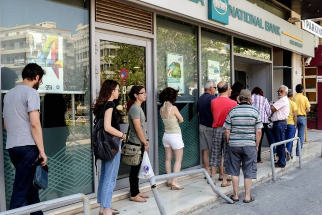 Mandatory Credit: Photo by REX Shutterstock (4886027b)  People queue to use an atm outside a closed branch of the Ntional Bank of Greece  Banks closed in Greece - 29 Jun 2015