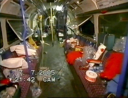 Image contains still from CCTV inside a badly damaged London tube carriage.