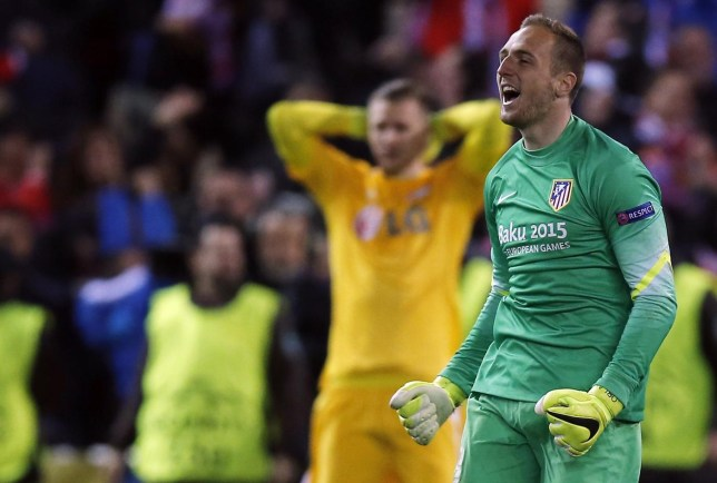 Atletico Madrid's goalkeeper Jan Oblak celebrates victory after winning the penalty shoot-out at the end of his Champions League round of 16 second leg soccer match against Bayer Leverkusen in Madrid Sergio Perez/Reuters
