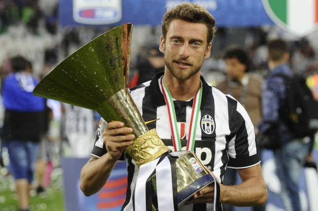 Football: Juventus' Claudio Marchisio celebrates winning the Italian Serie A with the trophy after the match Reuters/Reuters