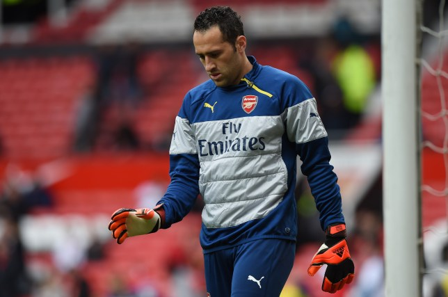 Arsenal's Colombian goalkeeper David Ospina warms up before the English Premier League football match between Manchester United and Arsenal at Old Trafford in Manchester, northwest England, on May 17, 2015. AFP PHOTO / PAUL ELLIS RESTRICTED TO EDITORIAL USE. No use with unauthorized audio, video, data, fixture lists, club/league logos or live services. Online in-match use limited to 45 images, no video emulation. No use in betting, games or single club/league/player publications        (Photo credit should read PAUL ELLIS/AFP/Getty Images)
